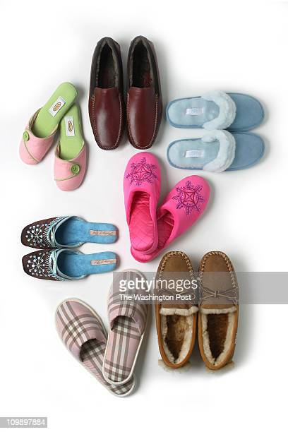 12/20/04 PHOTO Julia Ewan/The Washington Post From center clockwise Cole Haan outdoor shearling slippers in burgundy at Neiman Marcus or...
