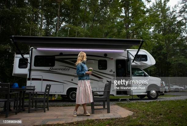 Washington Post travel writer Andrea Sachs stands outside of her rented RV Saturday, September 19, 2020 at a KOA campground in Fredericksburg,...