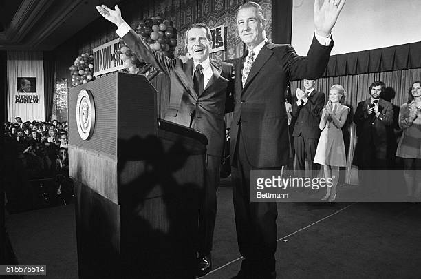 Pres Nixon and VicePres Agnew flash victory smiles as they appear at Republican election night headquarters in the Shoreham Hotel after the President...
