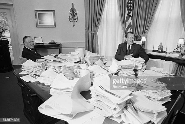 Pres Nixon sat at his desk in his oval office 11/4 looking at stacks of wires from across the country that were piled high on his desk He said he was...