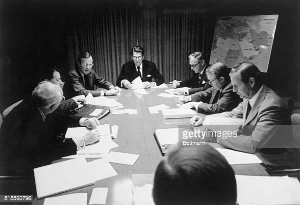 Pres Reagan meets with his National Security Advisers on the Egyptian situation following the shooting of Pres Anwar Sadat Left to right are Director...