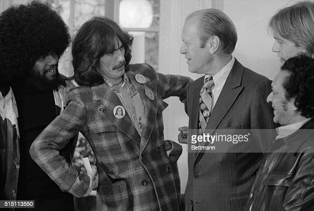 President Ford is greeted in the Oval Office of the White House December 13th by former Beatle George Harrison who was hosted to a luncheon at the...