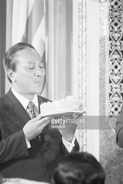 President Nguyen Van Thieu of South Vietnam blows out a candle on a birthday cake presented to him at the National Press Club Thieu who celebrates...