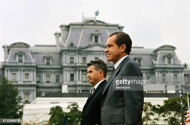 President Nixon and Romanian President Nicolae Ceausescu stand on reviewing stand during White House ceremony in honor of visiting Presidentthe first...
