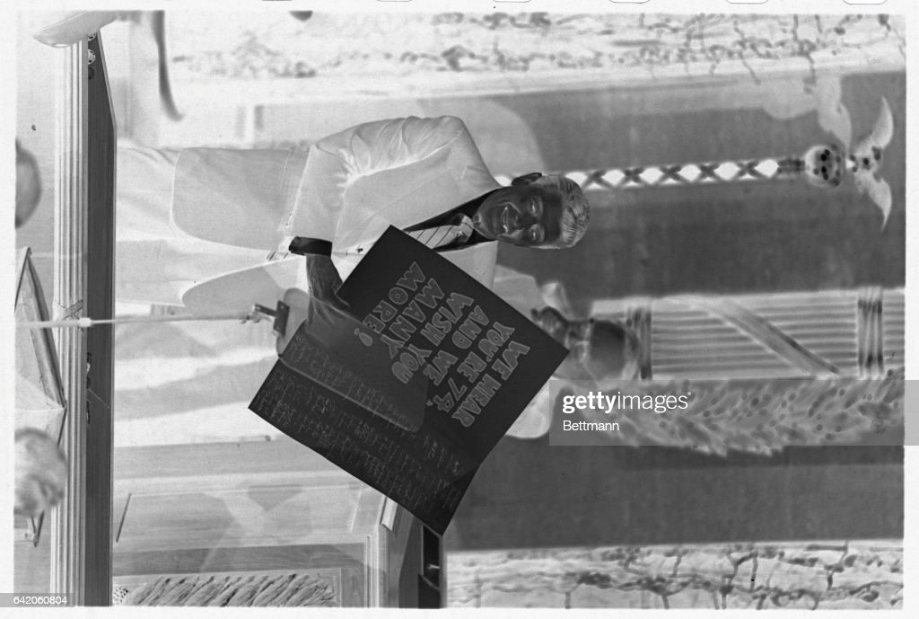 Ronald reagan holding large card pictures getty images president reagan displays a birthday card presented to him at the conclusion of his state of bookmarktalkfo Choice Image