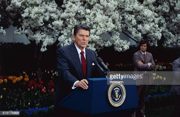 """Washington: President Reagan in a meeting with reporters in the Rose Garden of the White House, says he is """"prepared to go the extra mile"""" in..."""