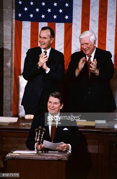 President Reagan is applauded by Vice President George Bush and Speaker Thomas O'Neill before delivering his State of the Union