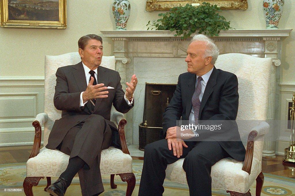 Eduard Shevardnadze and Ronald Reagan Conversing : News Photo