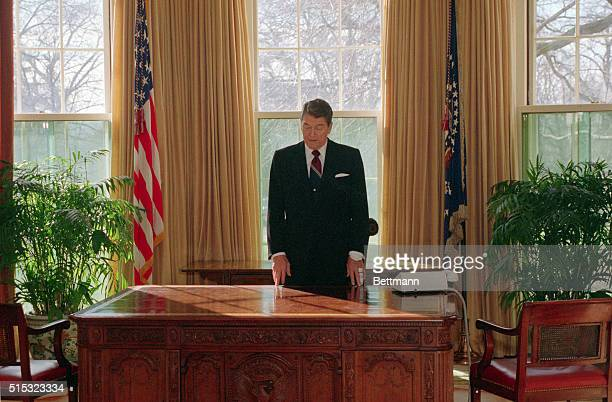 President Reagan takes a last look at his new empty desk in the Oval Office in the White House prior to leaving for inaugural ceremonies at the...