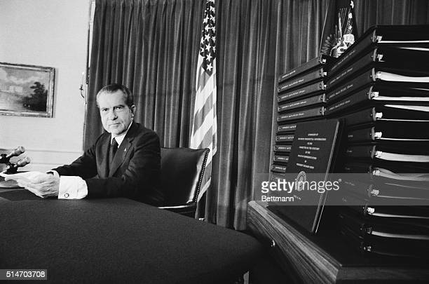 President Richard Nixon conceding that his refusal to surrender secret White House tapes had 'heightened the mystery about Watergate' and caused...