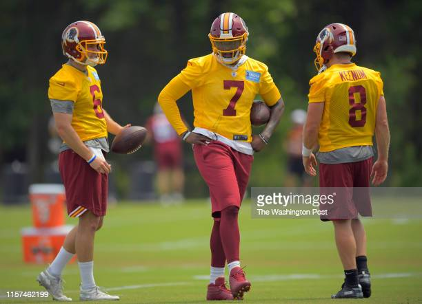 Washington quarterbacks Josh Woodrum left Dwayne Haskins Jr center and Case Keenum during an OTA at Redskins Park in Ashburn VA on May 29 2019