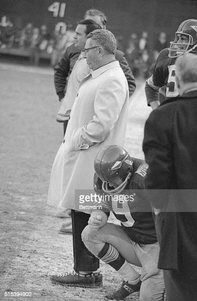 Washington Redskin quarterback Sonny Jurgenson with Coach Vince Lombardi on sidelines during game against Dallas Cowboys