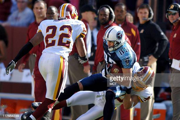 Washington Redskins' Adam Archuleta knocks Tennessee Titans' Drew Bennett out of bounds at FedEx Field in Washington DC Sunday October 15 2006 The...