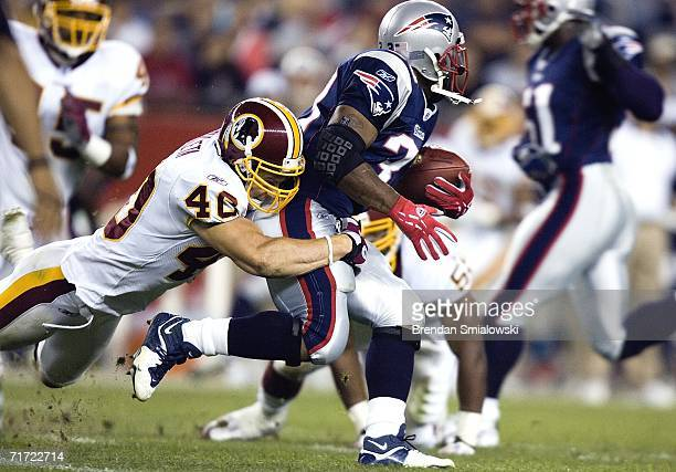 Washington Redskins Adam Archuleta tackles New England patriots Kevin Faulk during the first half of a preseason game at Gillette Stadium August 25...