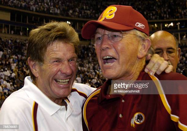 Washington Redskins assistant head coach Joe Bugel and coach Joe Gibbs celebrate a lastminute win against the Dallas Cowboys in a Monday Night...