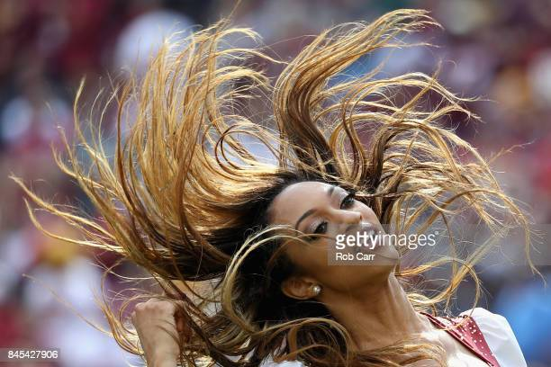Washington Redskins cheerleader performs against the Philadelphia Eagles at FedExField on September 10 2017 in Landover Maryland