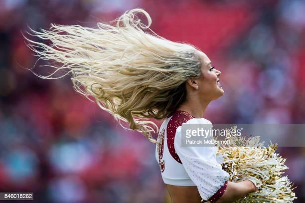 Washington Redskins cheerleader performs against the Philadelphia Eagles at FedExField on September 10 2017 in Landover Maryland