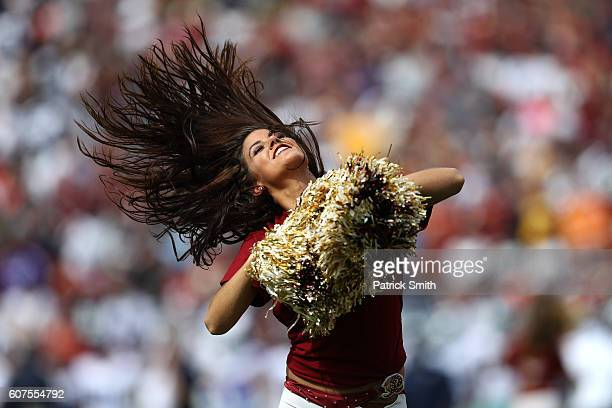 Washington Redskins cheerleader performs during a game against the Dallas Cowboys at FedExField on September 18 2016 in Landover Maryland