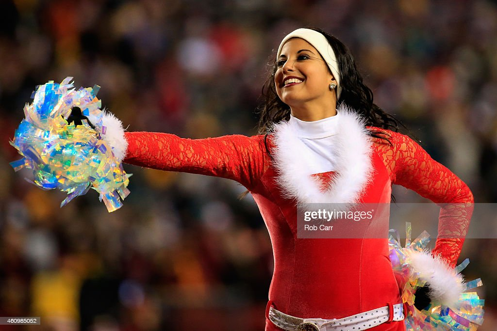 A Washington Redskins cheerleader performs during the Redskins and Philadelphia Eagles game at FedExField on December 20, 2014 in Landover, Maryland.
