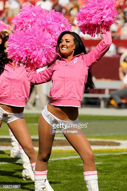 Washington Redskins cheerleader performs on the field prior to a game on October 10 2010 against the Green Bay Packers at Fedex Field in Landover...