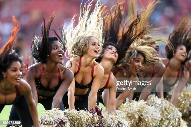 Washington Redskins cheerleaders dance during a stoppage in play as the Washington Redskins play the Cincinnati Bengals in the second half during a...