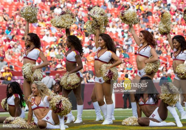 Washington Redskins cheerleaders during a timeout within the NFL preseason game between the Cincinnati Bengals and the Washington Redskins on August...