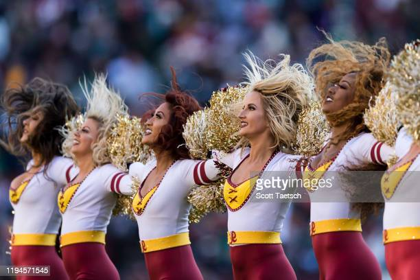 Washington Redskins cheerleaders perform during the first half of the game against the Philadelphia Eagles at FedExField on December 15, 2019 in...
