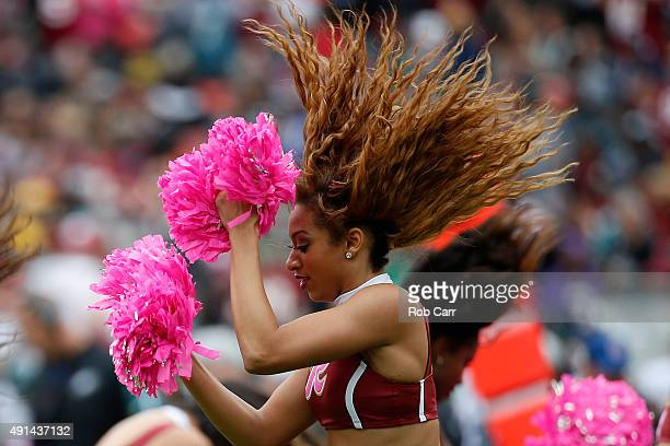 Washington Redskins cheerleaders perform during the first half of the Redskins and Philadelphia Eagles game at FedExField on October 4 2015 in...