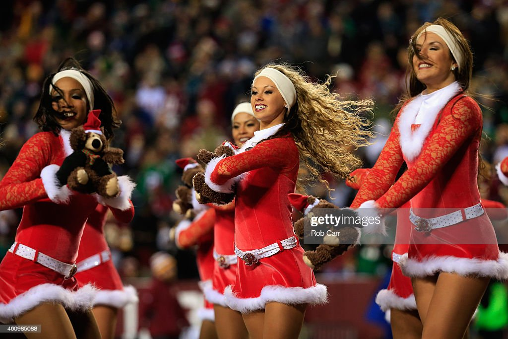 Washington Redskins cheerleaders perform during the Redskins and Philadelphia Eagles game at FedExField on December 20, 2014 in Landover, Maryland.