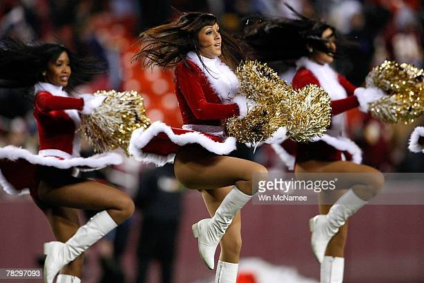 Washington Redskins cheerleaders perform in Christmas costumes during halftime in a game against the Chicago Bears at FedEx Field December 6 2007 in...