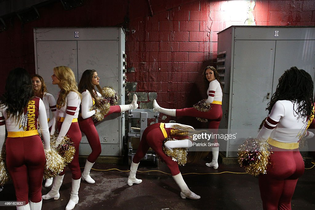 Washington Redskins cheerleaders stretch before a game against the New York Giants at FedExField on November 29, 2015 in Landover, Maryland.
