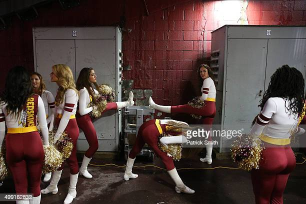 Washington Redskins cheerleaders stretch before a game against the New York Giants at FedExField on November 29 2015 in Landover Maryland