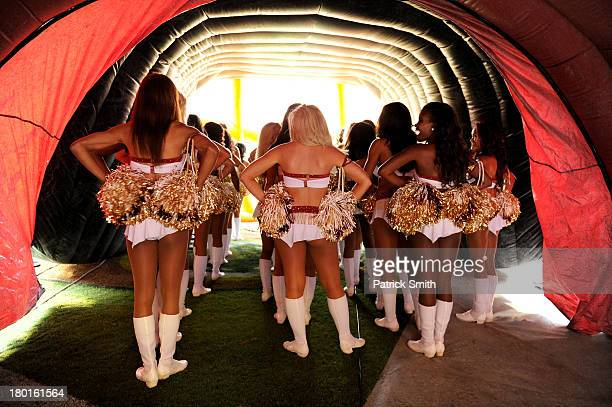 Washington Redskins cheerleaders wait in the tunnel before running out on the field against the Philadelphia Eagles at FedExField on September 9 2013...