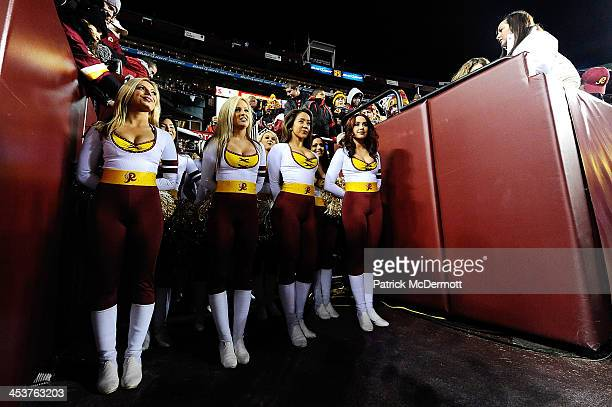 Washington Redskins cheerleaders wait to run onto the field before the start of an NFL game between the New York Giants and Washington Redskins at...