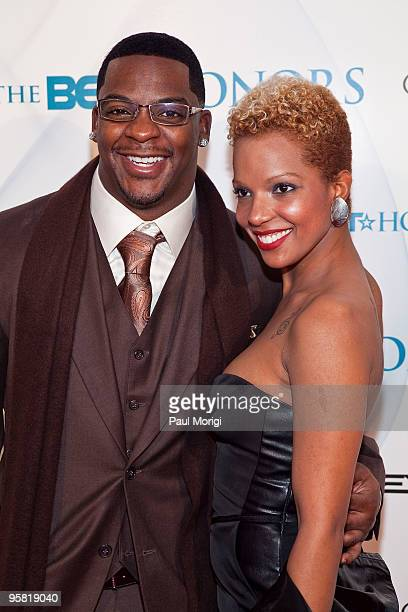 Washington Redskins' Clinton Portis and guest arrive to the 3rd annual BET Honors at the Warner Theatre on January 16 2010 in Washington DC
