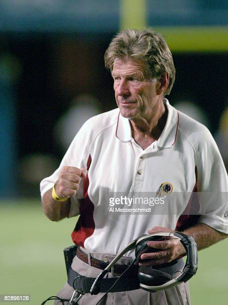Washington Redskins coach Joe Bugel watches play against the Miami Dolphins August 21 2004 in Miami