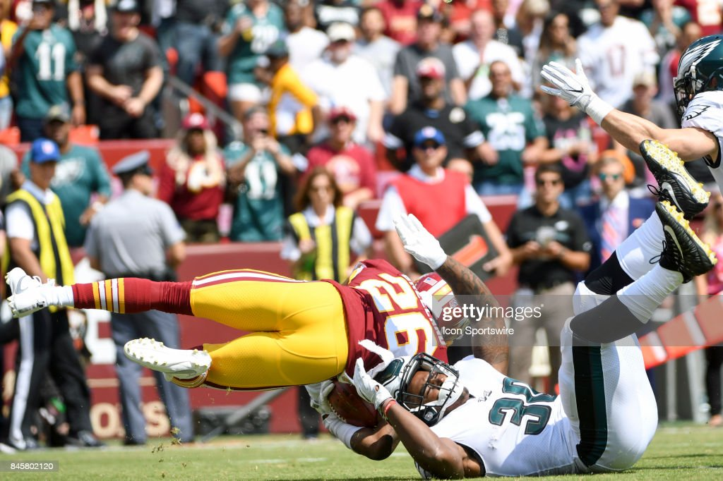 Washington Redskins cornerback Bashaud Breeland (26) is brought down by Philadelphia Eagles running back Corey Clement (30) on a kick off return on September 10, 2017, at FedEx Field in Landover, MD.