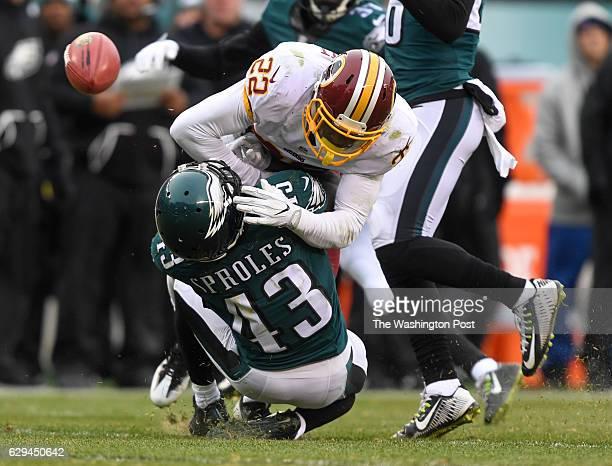 PHILADELPHIA PA DECEMBER Washington Redskins cornerback Deshazor Everett hits Philadelphia Eagles running back Darren Sproles before he can catch the...