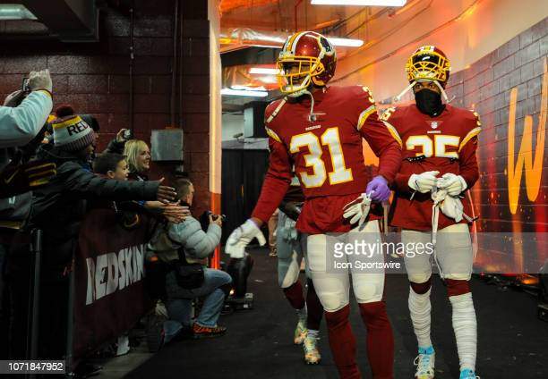 Washington Redskins cornerback Fabian Moreau followed by strong safety Montae Nicholson walk out of the tunnel for the game against the New York...