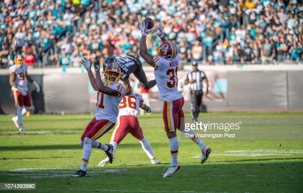 Washington Redskins cornerback Fabian Moreau intercepts a pass intended for Jacksonville Jaguars wide receiver Dede Westbrook during the fourth...