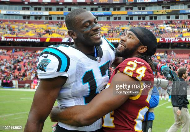 Washington Redskins cornerback Josh Norman hugs Carolina Panthers wide receiver Devin Funchess following their game on October 14 at FedEx Field in...