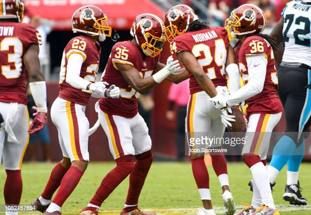 Washington Redskins cornerback Josh Norman is 'arrested' by strong safety Montae Nicholson and free safety DJ Swearinger after his interception...