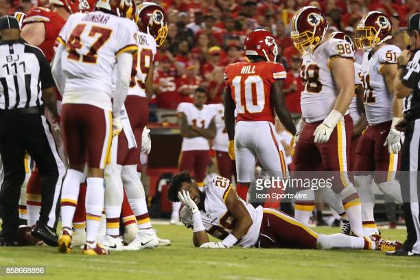 Washington Redskins cornerback Kendall Fuller lays on the field injured after Kansas City Chiefs running back Kareem Hunt's shoe stuck inside his...