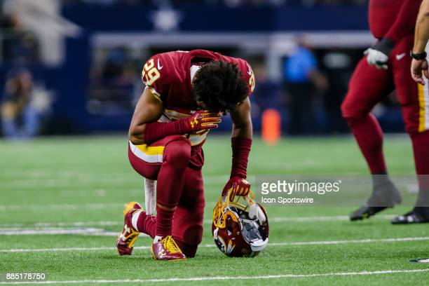 Washington Redskins cornerback Kendall Fuller takes a knee after an injured player is carted off the field during the game between the Dallas Cowboys...