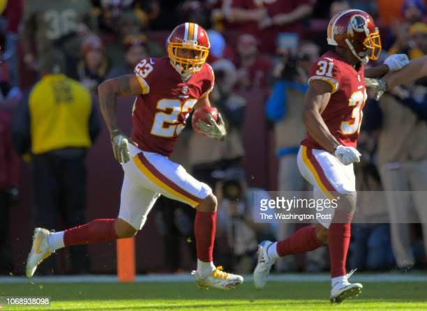 Washington Redskins cornerback Quinton Dunbar left with an interception follows Washington Redskins cornerback Fabian Moreau during a game between...