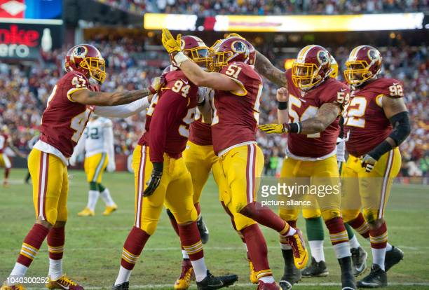 Washington Redskins defense celebrates after forcing a safety early in the first quarter against the Green Bay Packers in an NFC Wild Card game at...