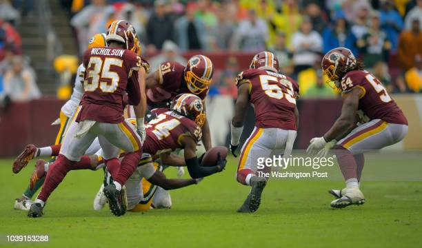 Washington Redskins defensive back Josh Norman scopes up a 4th quarter fumble by Green Bay Packers wide receiver Randall Cobb that was striped by...