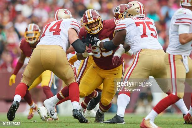 Washington Redskins defensive end Jonathan Allen battles with San Francisco 49ers offensive tackle Joe Staley and San Francisco 49ers offensive guard...