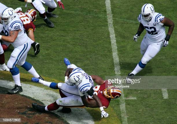 Washington Redskins defensive end Jonathan Allen takes down Indianapolis Colts running back Marlon Mack for a loss during a match between the...