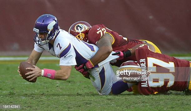 Washington Redskins defensive end Stephen Bowen and Washington Redskins linebacker Lorenzo Alexander sack Minnesota Vikings quarterback Christian...